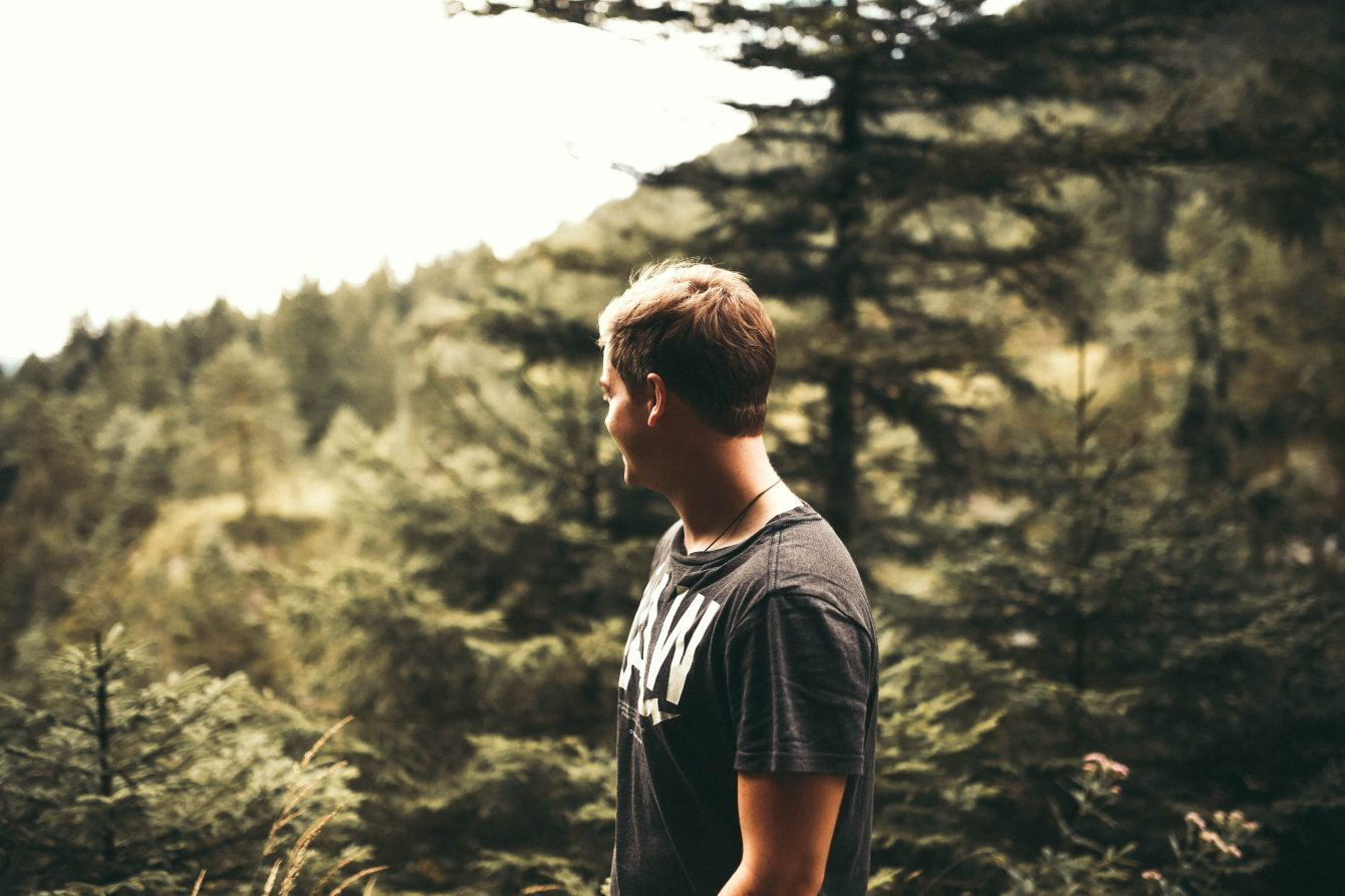 Man Standing Near Forest Trees